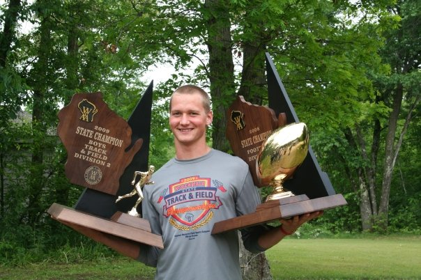 Jared with state championship trophies